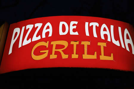 July 2, 2020 Beltsy or Balti, Moldova Glowing in the dark inscription of food service Pizza from Italy grill. Editorial Use Only