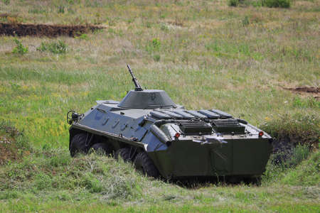 Armored personnel carrier infantry fighting vehicle. Military background with copyspace. Banque d'images