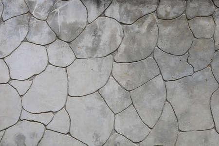Old rough grunge textured wild stone wall background Archivio Fotografico