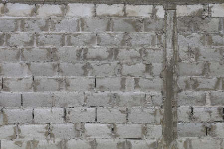 Rough textured grunge wall made of large blocks, background Foto de archivo - 153589202