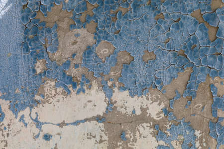 Very beautiful textured old grunge wall with peeling and cracked paint, background