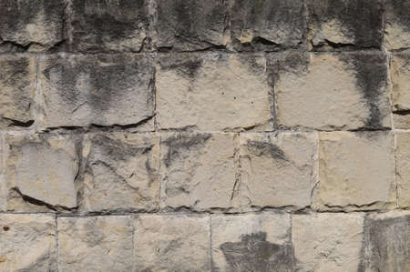 Old textured grunge block wall. Background or graphic resource for design