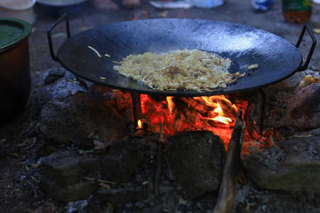 Abstract background on the theme of cooking in a camping or hiking setting. Selective focus with blurred background