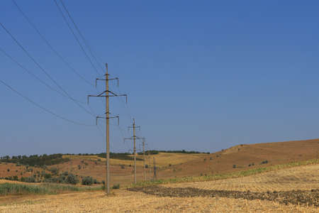 Power lines in a field outside the city 写真素材