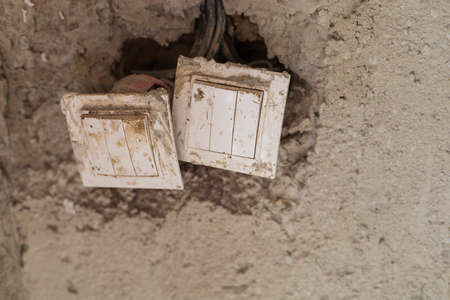 Temporary switches in cement plaster for the period of building a house. Selective focus with copy space. Background