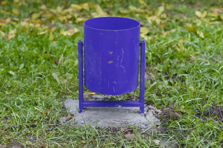 A classic common trash can in an urban environment or city parks. Selective focus background Banque d'images
