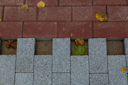 Repair of sidewalks in an urban environment. Abstract background with selective focus. Stockfoto