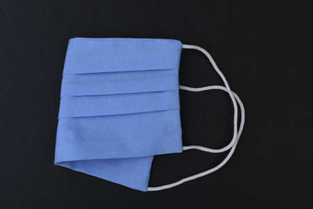 A clean and new medical surgical mask that must be worn in public during the period of the infectious disease pandemic