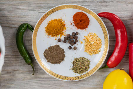 Various spices. Culinary background with selective focus and blurred background.