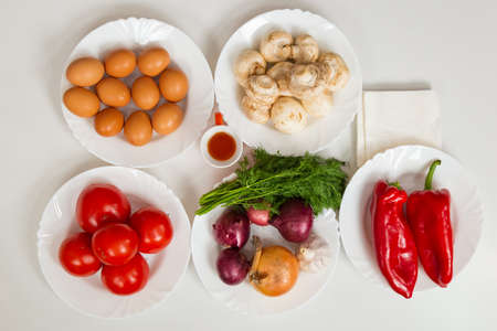 Eggs, mushrooms and vegetables. Culinary background with selective focus and blurred background.