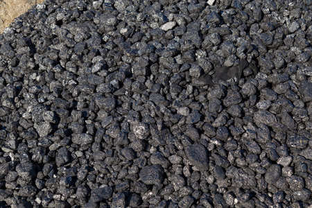 Natural black coals for universal illustrative background. Industrial coals. Used as a household fuel, energy fuel, raw material for the metallurgical and chemical industries Archivio Fotografico