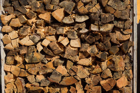 Firewood for home heating and cooking on an open fire. Background