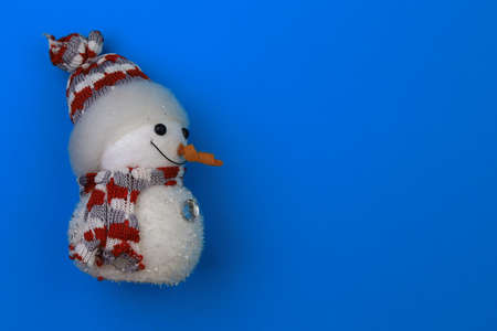 New Year snowman symbol. The traditional stereotype of the Christmas holidays. Copy space for text or inscription