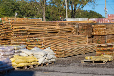 Wood planks for sale. Stacks of processed wood at the timber yard. Background
