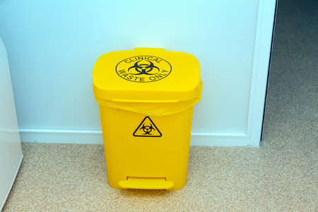 Waste bin for medical biohazard waste in the hospital laboratory. Background