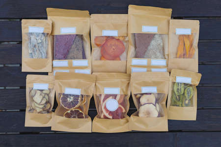 Dried fruits packaged in eco-friendly paper bags. Healthy desserts concept. Natural substitutes for sugar in the diet.