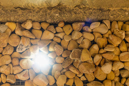 Natural stones in interior decor with lighting in the dark. Background Imagens