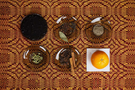 Ingredients for making mulled wine. A classic recipe from the Nordic Scandinavian countries. Background with layout