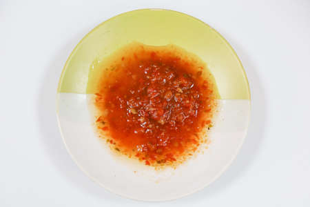 Spicy oriental adjika in a platter. Used as a sauce and seasoning for a dish. Background Stok Fotoğraf