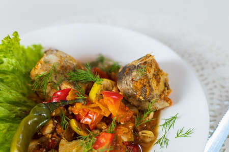 Sea fish stewed with vegetables.
