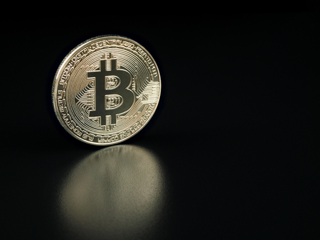 electronic commerce: Silver bitcoin on black background. Bitcoin cryptocurrency