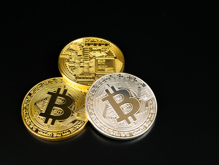 bitcoin network: Golden and silver bitcoin on black background. Bitcoin cryptocurrency