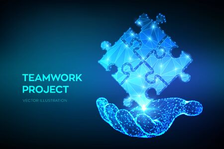 Teamwork. Puzzle elements in hand. Team metaphor. Symbol of teamwork, cooperation, partnership, association and connection. Polygonal puzzle pieces. Business concept of connecting. Vector 写真素材 - 127198575