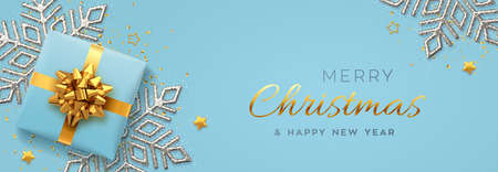 Christmas banner. Realistic blue gift box with golden bow, silver shining snowflake, gold stars and glitter confetti. Xmas background, horizontal poster, greeting cards, headers website. Vector