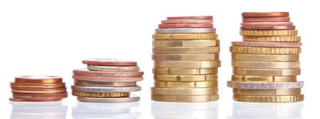 stack of coins on white background . photo