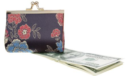 horizontal position: purse on top of a dollars, in a horizontal position , a pack of dollars