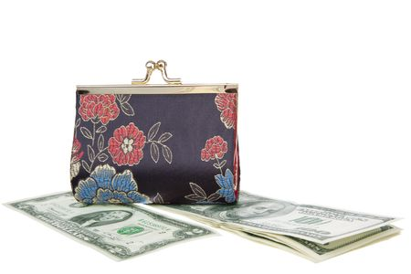 horizontal position: purse on top of a dollars, in a horizontal position