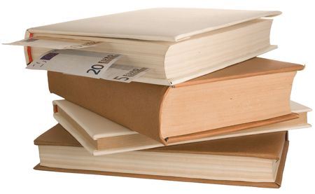 bibliomania: stack of books with the money