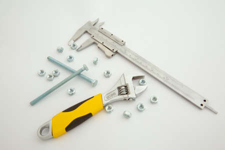 bolts, nuts, vernier caliper and spanner photo