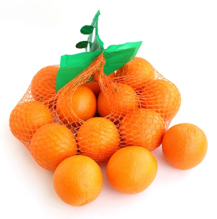 The ripe oranges are packed in the grid  Isolated on a white background   photo