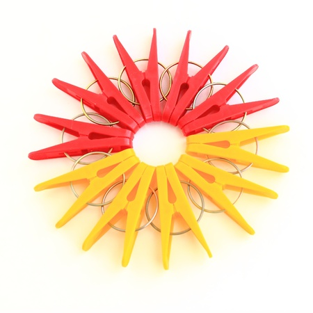 yellow and   red clothes peg isolated on a white background  photo