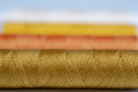 Colorful spools of thread form a beautiful rainbow Stock Photo