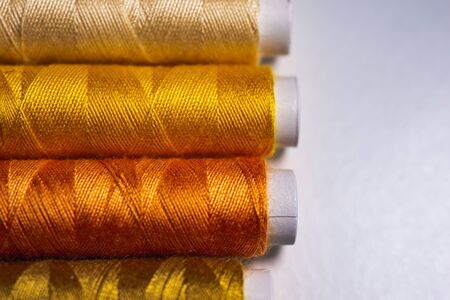 Colorful spools of thread form a beautiful rainbow