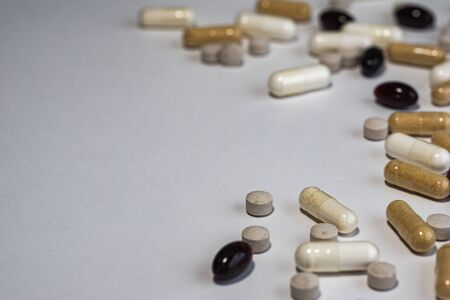 Drug prescription for treatment medication. Pharmaceutical medicament, cure in container for health. Pharmacy theme, Heap of  capsule pills with medicine antibiotic in packages.