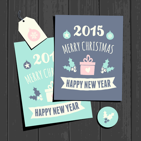 A set of two Christmas greeting card templates, a gift tag and a round sticker on a gray wooden background. Vector