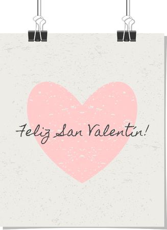 Vintage style poster for Valentines Day with a pastel pink heart and text. Feliz San Valentin! - Spanish for Happy Valentines Day!. Poster design mock-up with paper clips, isolated on white. Vector