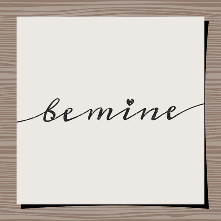 handlettering: Hand-drawn typographic design template for Valentines Day. Paper note on wood background mock-up. Be Mine message. Illustration