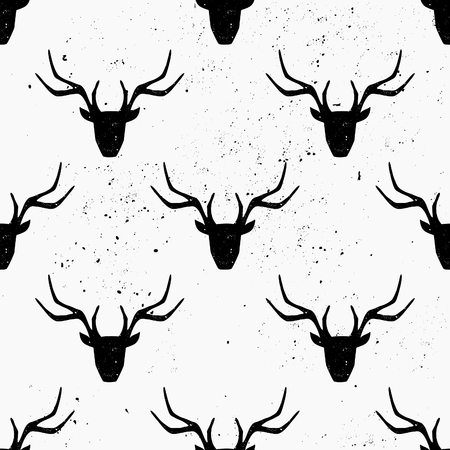 Deer head silhouette seamless pattern in black and white.