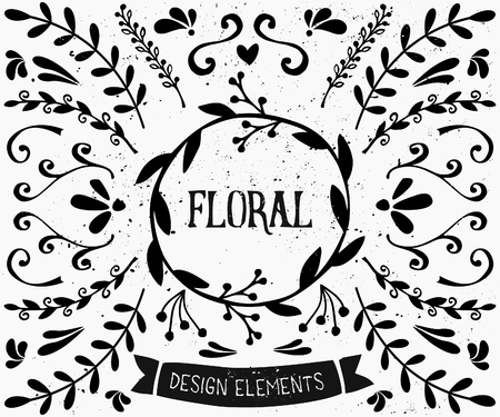 A set of vintage style floral design elements in black and white. Hand drawn decorative elements and embellishments. Borders, laurels, swirls, wreaths and other retro style graphics.