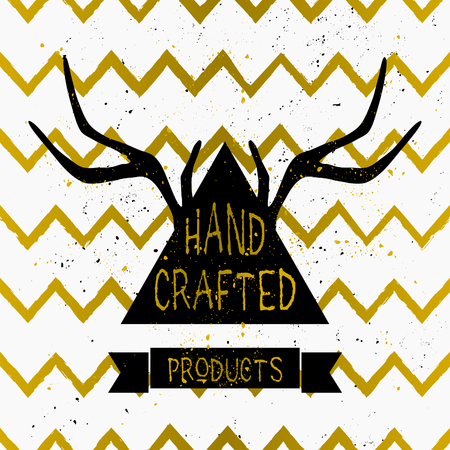 hand crafted: Trendy product label design in black, white and gold. Triangle shape and antlers silhouette with hand lettered style text on white and gold chevron background.