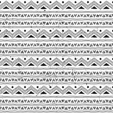 Seamless hand drawn style tribal pattern in black and white.
