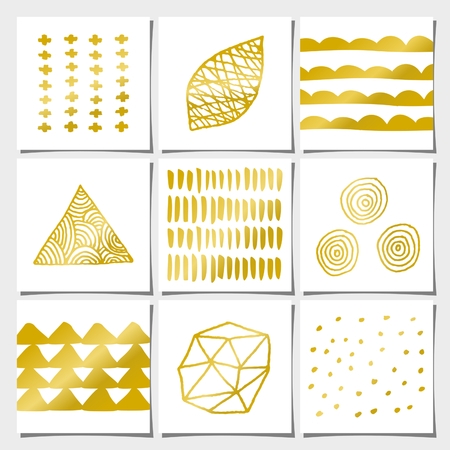 A set of nine abstract geometric designs in white and golden. Brush strokes, doodles, organic patterns and shapes. Vector