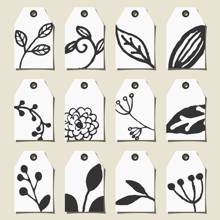 A set of twelve hand drawn floral design labels in black and white. Vector