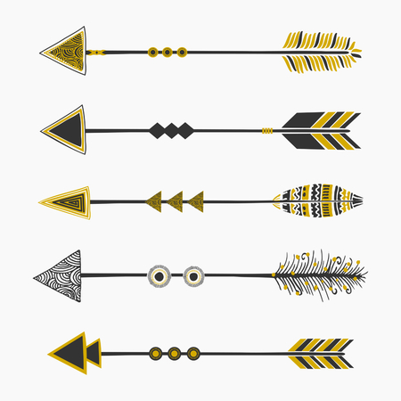 native american art: A set of five arrows, tribal decoration in black and golden, isolated on white.