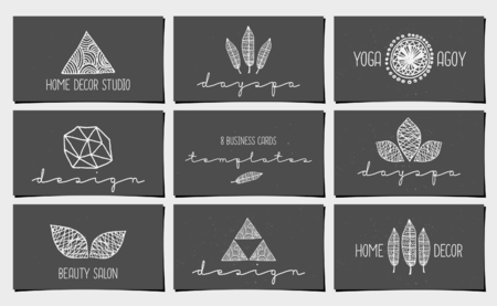 A set of nine modern and elegant business card templates in chalkboard style. Hand drawn design elements, feathers, leaves, triangles, geometric shapes. Vector
