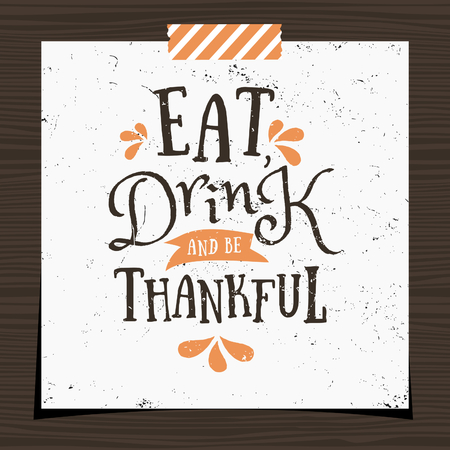 give: Thanksgiving typographic design greeting card template. Eat, Drink and Be Thankful message in black and orange on white background. Greeting card for Thanksgiving Day with a strip of washi tape on dark wood background.